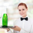 Pretty young waitress serving champagne in restaurant — Stock Photo #18838385