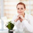 Elegant young woman having coffee in modern restaurant — Stock Photo #18838447