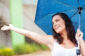 Attractive young woman having fun in the rain — Stock Photo