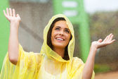 Happy young woman playing in the rain — Stock Photo
