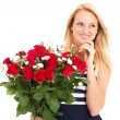 Stock Photo: Attractive young womreceived bunch of roses from secret admirer