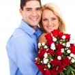 Loving young couple with roses on valentine's day — Stock Photo