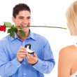 Young man with rose and ring proposing to his girlfriend — Stock Photo