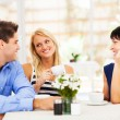 Happy young man meeting mother in law with his wife - Stockfoto