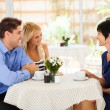 Young woman with boyfriend meeting future mother in law in cafe — Stock Photo