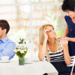 Stock Photo: Caring mother standing by her daughter when she has marriage problem