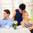Caring mother reconciling fighting young couple — Stock Photo
