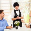 Friendly middle aged waitress taking order from customer in restaurant — Stock Photo #19082347