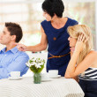 Mother pointing finger at son-in-law as she took daughter's side when couple fighting — Stock Photo