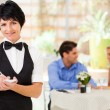 Elegant mature waitress working in restaurant — Stock Photo
