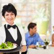 Pretty middle aged waitress working in restaurant — Stock Photo