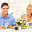 Young couple having lunch in restaurant — Stok fotoğraf