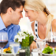 Loving young couple dining out in restaurant — Stock Photo