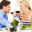 ストック写真: Loving young couple drinking wine in restaurant