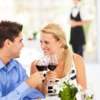 Happy young couple eating out in restaurant — Foto de Stock