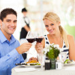 Foto Stock: Young couple drinking wine in restaurant