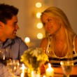 Foto Stock: Young couple enjoying candlelight dinner in restaurant