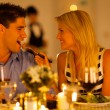 Loving couple having romantic dinner in a restaurant - Stock Photo