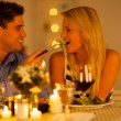 Foto Stock: Young couple having romantic dinner together in a restaurant