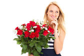Attractive young woman received bunch of roses from secret admirer — Stock Photo