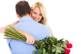 Young woman hugging boyfriend with bunch of roses — Stock Photo