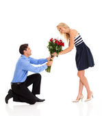 Young woman accepting roses from a man on valentine's day — Stock Photo