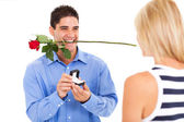 Young man with rose and ring proposing to his girlfriend — Foto de Stock