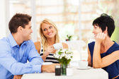 Happy young man meeting mother in law with his wife — Stock Photo
