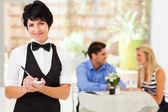 Elegant mature waitress working in restaurant — Stock Photo