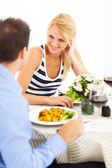 Happy young couple dining out — Fotografia Stock