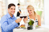 Young couple drinking wine in restaurant — Stock Photo
