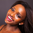 Happy young african american woman face closeup — ストック写真