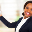 Cheerful african american businesswoman presenting — Stock Photo