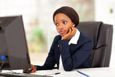 Thoughtful african american businesswoman looking at computer screen in office — Stock Photo