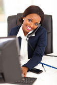 Pretty female african corporate worker working in office — Stock Photo