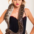 Stock Photo: Sexy blonde woman posing with python