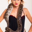 Sexy blonde woman posing with python — Stock Photo