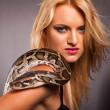 Attractive young woman with python on her shoulder — Stock Photo