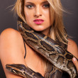 Attractive young woman with python around her neck — Stock Photo