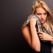 Beautiful young blonde woman holding python — Stock Photo