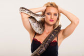 Sexy young blonde woman posing with python — Stock Photo