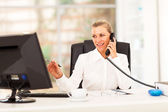 Happy middle aged businesswoman working in office — Stock Photo