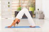 Senior woman doing yoga at home — Stock Photo