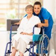 Stock Photo: Elderly womand young caregiver at home