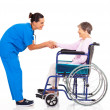 Friendly nurse greeting disabled senior patient — Stock Photo