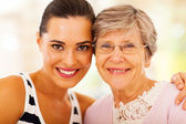 Happy woman and senior mother closeup portrait — Stock Photo