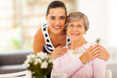Pretty woman and senior mother at home — 图库照片
