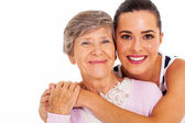 Happy senior mother and adult daughter closeup portrait on white — Stok fotoğraf