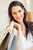 Attractive young woman with shopping bags — Stock Photo