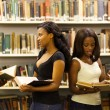 Group of african american students in library — Stock Photo #20130593
